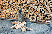 Oak firewood stacked in a pile.