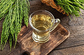 A cup of herbal tea with fresh horesetail