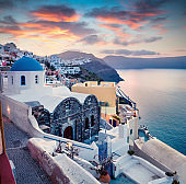 Dramatic morning view of Santorini island. Picturesque spring sunrise on the famous Greek resort Oia, Greece, Europe. Traveling concept background. Artistic style post processed photo.