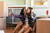 Young Lesbian Couple is Celebrating Buying of New Apartment