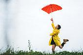 Woman holding umbrella on wind