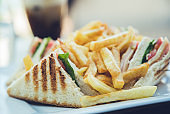 Club sandwich and French fries on s plate