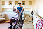 Senior Man in a Wheelchair Doing Sports Recovery
