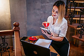 Businesswoman multi-tasking in cafe