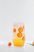 Citrus cold drink with fruits.