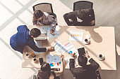 Marketing Analysis Accounting Team Teamwork Business Meeting Concept. Top view in office while people having a meeting