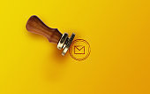 Mail Rubber Stamp Against Yellow Background