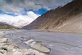 Natural view along mountains Hunza valley in autumn season surrounded by Karakoram mountain range in Pakistan asia