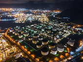 Oil and gas refinery plant and storage tank form industry zone with sunset background, Oil and gas Industrial petrochemical fuel power and energy, Ecosystem and ecology environment.