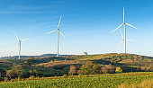 Nature wind turbines and solar panels with high voltage electricity power line for clean energy in mountains