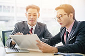 Large group of asian financial advisor business sale team people and helping business customer to find a solution for business and advice financial planning for business investment for people