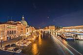 Canal Grande and Basilica di Santa Maria della Salute, Chrunch ,Venice, Italy, with tourist enjoy travel on the water gondola boat