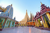 Famous Shwedagon Pagoda (Stupa) with visitors, tourists and locals walking around the golden pagoda