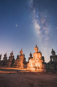 Milky way galaxy with buddha stature landscape nature  In Nakhon Si Thammarat Thailand
