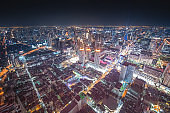 Panoramic view Cityscape business district ( silom , Sathorn , Bangrak ,Bangkok, Thailand) from aerial view high building at dusk