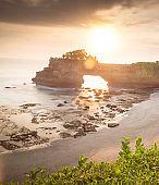 Sunset near famous tourist landmark of Bali island - Tanah Lot & Batu Bolong temple.  Bali Indonesia. Tropical nature landscape of Indonesia, Bali.