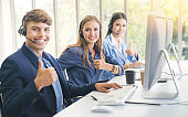 Asian online marketing business  team people and call center and it support helping customer to find a solution for business and advice customer in homeoffice