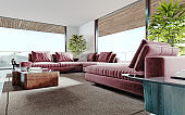 Living room with a large pink sofa and a TV unit with shelves and decor. Living room studio with kitchen and living area. Large panoramic windows.