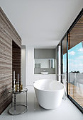 Modern nordic style bathroom. Bathroom with a large panoramic window and access to the terrace.