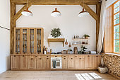 Wooden kitchen in modern interior with contemporary furniture