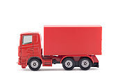 Red cargo delivery truck miniature isolated on white background with clipping path