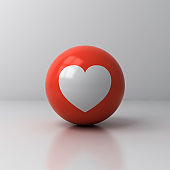 Love like heart icon on red sphere ball isolated on white room background with shadow and reflection