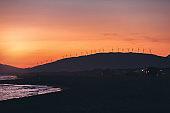 Photo of wind generator turbines on sunset