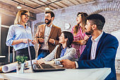 Business people working together in modern office.