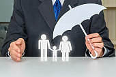 Businessman protects family members e.g parents and a child
