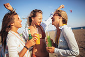 Group of three beautiful attractive young women having fun on the beach.