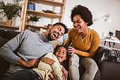 Happy african american family having fun at home.