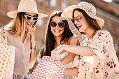 Beautiful women with shopping bags having fun.