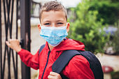 Child wear facemask during coronavirus and flu outbreak
