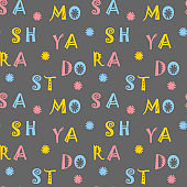 Colored letters on a dark background. Seamless pattern for fabric, packaging, covers and other surfaces. Vector