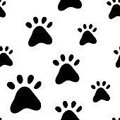 Paw prints a seamless pattern. Monochrome design