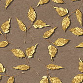 Gold seamless pattern of leaves