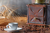 Cup of coffee with roasted coffee beans and mill