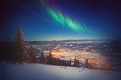 The Northern Light Aurora borealis ower winter land