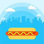 Hot dog on a background of cityscape with white clouds, fast food vector illustration