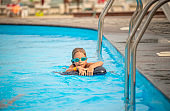 Charming little girl in swimming goggles