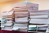 Pile of bunch education documents or books report teacher after approve and checking from admistrator, Annual Reports document for evaluation in student study in university office