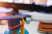 Graduated or Graduation university study  international Conceptual, Congratulations graduates hat on Earth world globe model with formula equation classroom. Studies lead to success , Back to School