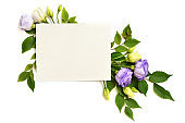 Eustoma flowers and a card in a floral composition