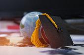 Graduated or Graduation university study  international Conceptual, Congratulations graduates hat with Earth world globe model, Jigsaw on classroom. Studies lead to success , Back to School