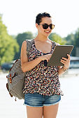 happy teenage girl with tablet pc and backpack