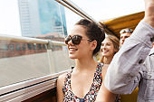 teenage girl with friends traveling by tour bus