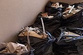 black plastic bags full of construction waste