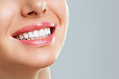 Perfect healthy teeth smile of a young woman. Teeth whitening. Dental clinic patient. Stomatology concept