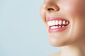 Perfect healthy teeth smile of a young woman. Teeth whitening. Dental care, stomatology concept