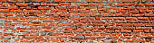 Ancient wall of many red bricks